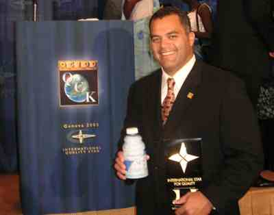Chief Fred Siaosi in Geneva Switzerland receiving the 'International Star for Quality' award for NHT Global Premium Noni Juice.